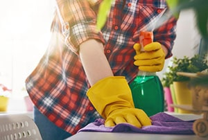Cleaner arrives to start a home clean.
